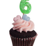 Cupcake with number five candle for six year anniversary